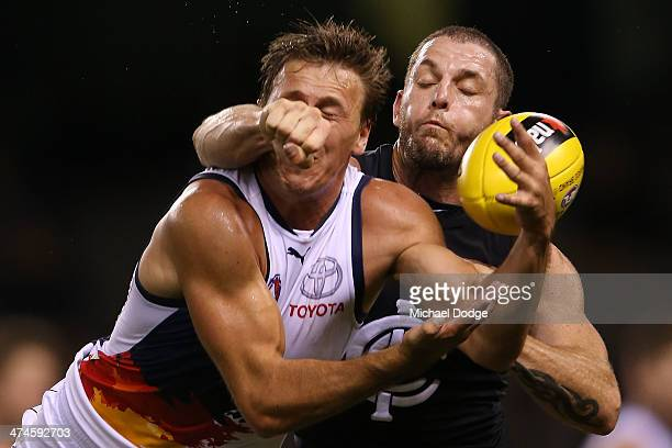 Mitch Grigg of the Crows and Heath Scotland of the Blues during the round three AFL NAB Challenge match between the Carlton Blues and the Adelaide...