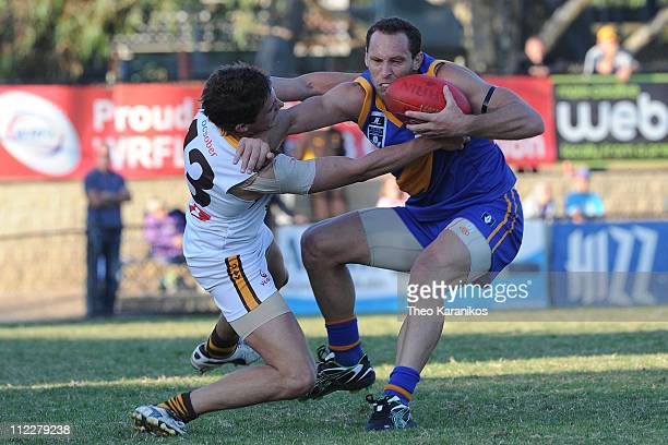 Mitch Hahn of Williamstown tries to break a tackle by Will Sierakowski of Box Hill during the round three VFL match between Williamstown and the Box...