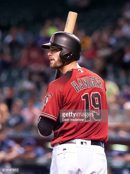 Mitch Haniger of the Arizona Diamondbacks looks at the third base coach before batting against the San Diego Padres in the second inning of the MLB...