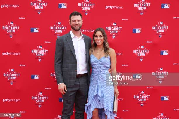 Mitch Haniger of the Seattle Mariners and the American League and guest attends the 89th MLB AllStar Game presented by MasterCard red carpet at...