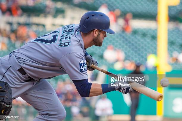 Mitch Haniger of the Seattle Mariners bunts the baseball for a first inning single during a MLB game against the Detroit Tigers at Comerica Park on...