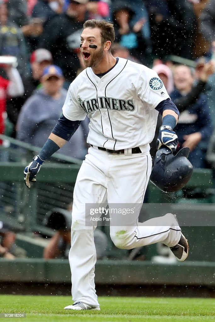 Mitch Haniger #17 of the Seattle Mariners celebrates after hitting the game winning two run home run in the ninth inning against the Los Angeles Angels of Anaheim during their game at Safeco Field on June 13, 2018 in Seattle, Washington.