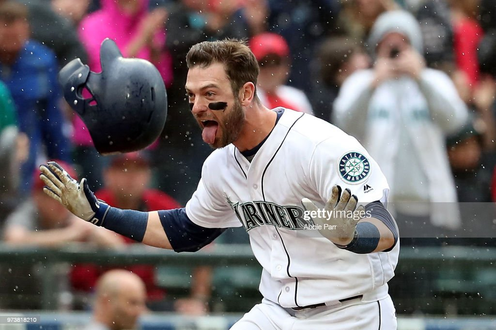Mitch Haniger #17 of the Seattle Mariners celebrates after hitting the game winning two run home run in the ninth inning against the Los Angeles Angels during their game at Safeco Field on June 13, 2018 in Seattle, Washington.