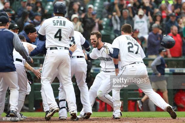 Mitch Haniger of the Seattle Mariners celebrates with teammates after hitting the game winning two run home run in the ninth inning against the Los...