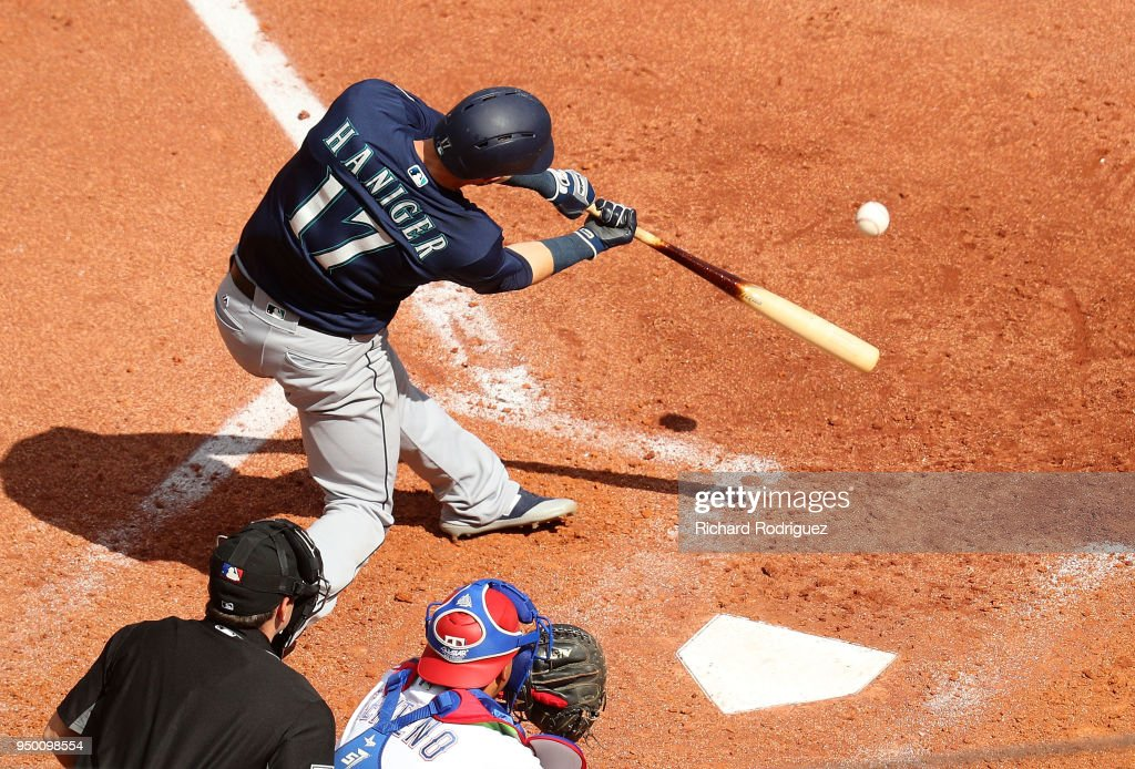 Mitch Haniger #17 of the Seattle Mariners connects for a home run in the seventh inning agaisnt the Texas Rangers at Globe Life Park in Arlington on April 22, 2018 in Arlington, Texas.