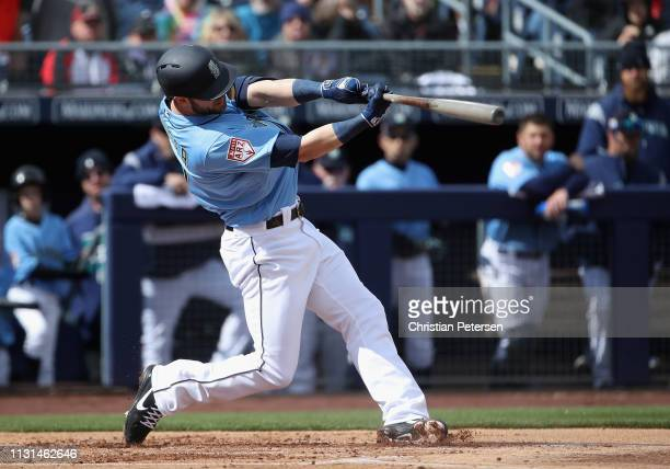 Mitch Haniger of the Seattle Mariners hits a tworun home run against the Oakland Athletics during the first inning of the MLB spring training game at...