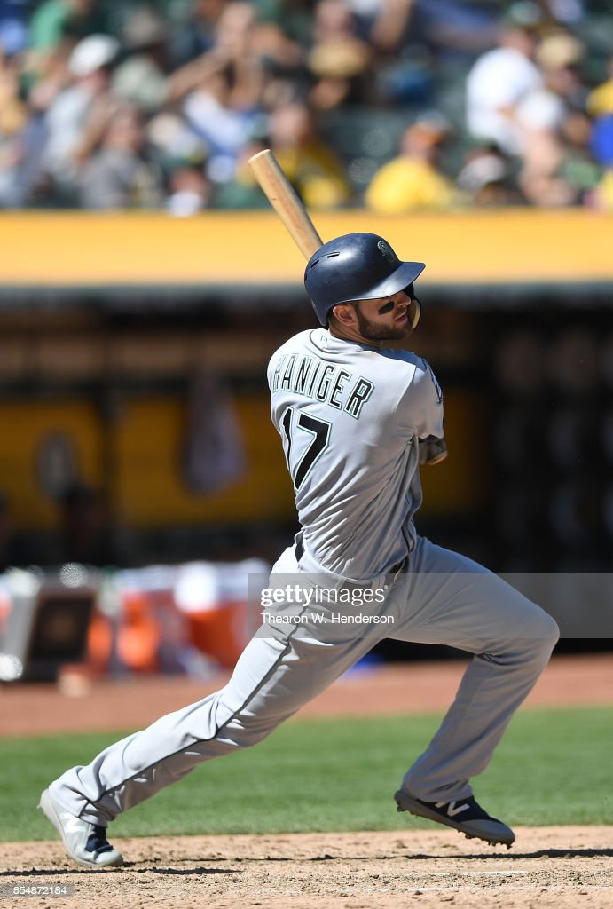 Mitch Haniger #17 of the Seattle Mariners hits an rbi single scoring Jacob Hannemann #13 against the Oakland Athletics in the top of the fifth inning at Oakland Alameda Coliseum on September 27, 2017 in Oakland, California.
