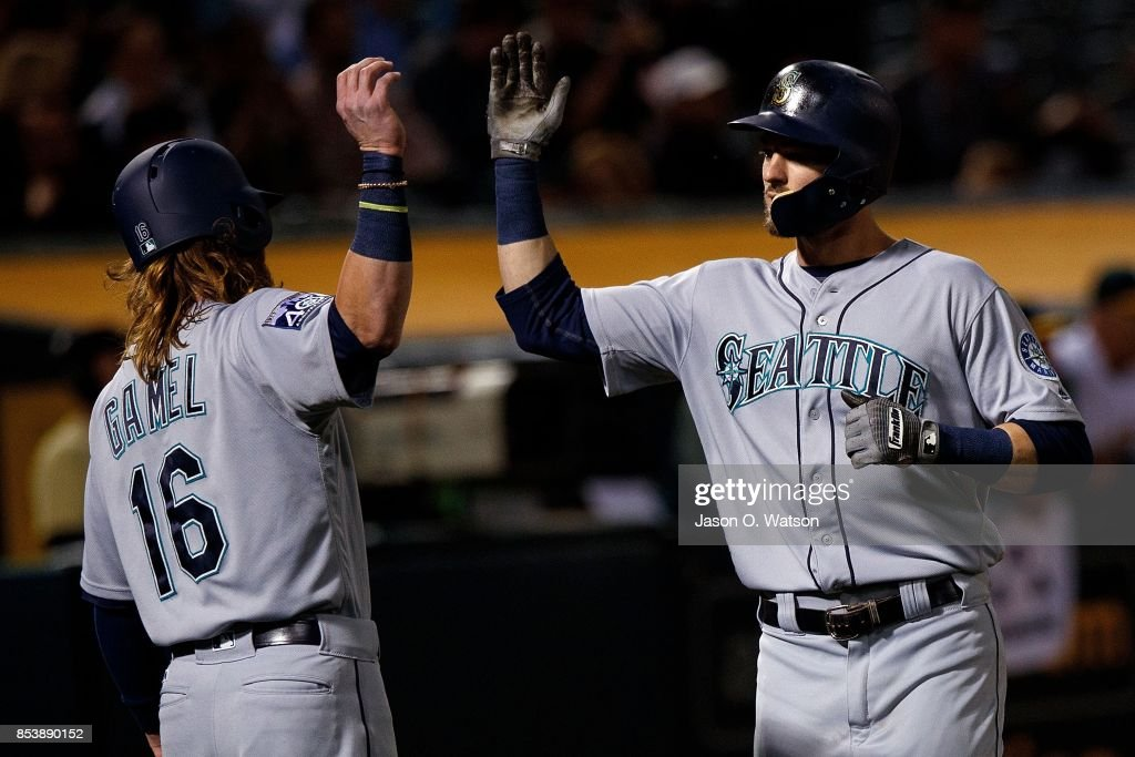 Mitch Haniger #17 of the Seattle Mariners is congratulated by Ben Gamel #16 after hitting two run home run against the Oakland Athletics during the fifth inning at the Oakland Coliseum on September 25, 2017 in Oakland, California. The Seattle Mariners defeated the Oakland Athletics 7-1.