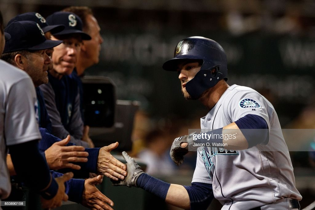 Mitch Haniger #17 of the Seattle Mariners is congratulated by teammates after hitting a home run against the Oakland Athletics during the third inning at the Oakland Coliseum on September 25, 2017 in Oakland, California. The Seattle Mariners defeated the Oakland Athletics 7-1.