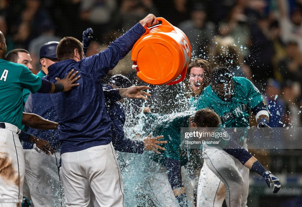 Mitch Haniger #17 of the Seattle Mariners is doused by Gatorade after hitting a walkoff solo home run off of relief pitcherMatt Andriese #35 of the Tampa Bay Rays during the thirteenth inning of a game at Safeco Field on June 1, 2018 in Seattle, Washington. The Mariners won 4-3 in thirteen innings.