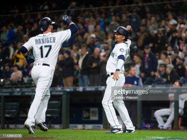 Mitch Haniger of the Seattle Mariners is greeted by JP Crawford after hitting a tworun home run in the fifth inning against the Oakland Athletics at...