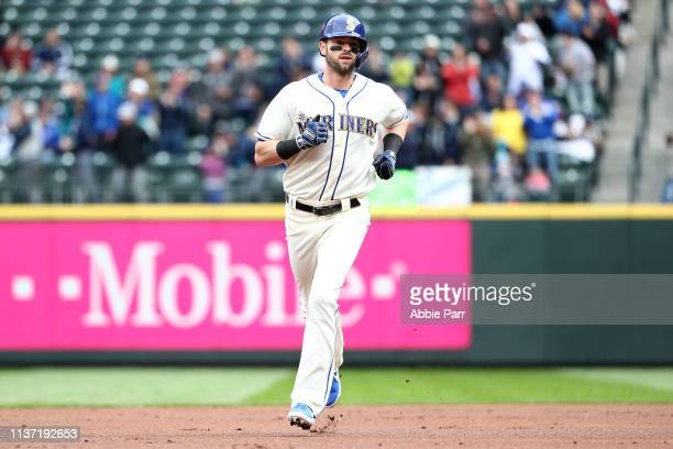 Mitch Haniger of the Seattle Mariners laps the bases after hitting a solo home run against the Houston Astros in the first inning during their game...