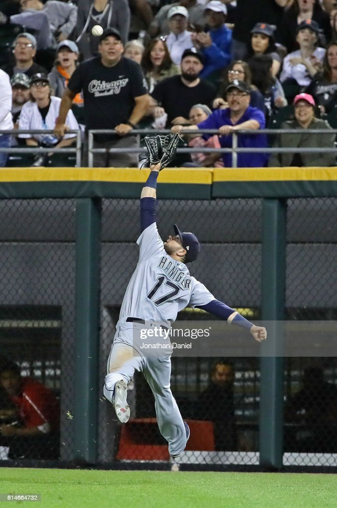 Mitch Haniger #17 of the Seattle Mariners makes a running, leaping catch in the 9th inning gainst the Chicago White Sox at Guaranteed Rate Field on July 14, 2017 in Chicago, Illinois. The Mariners defeated the White Sox 4-2.