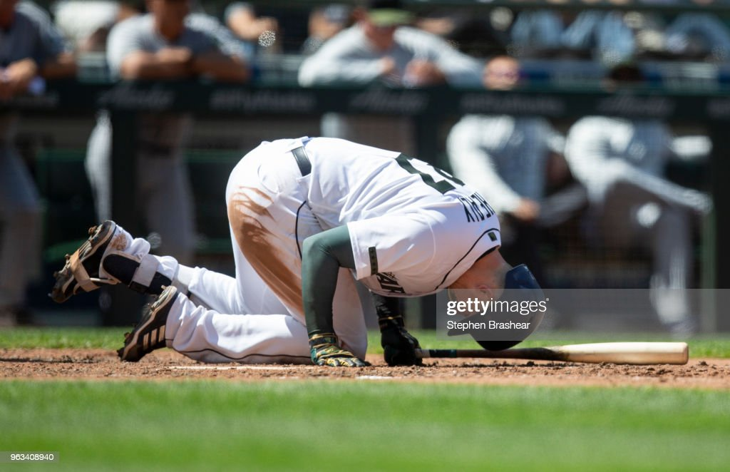 Mitch Haniger #17 of the Seattle Mariners reacts after fouling a pitch off his foot during the sixth inning of a game at Safeco Field on May 28, 2018 in Seattle, Washington. The Mariners won the game 2-1. MLB players across the league are wearing special uniforms to commemorate Memorial Day.