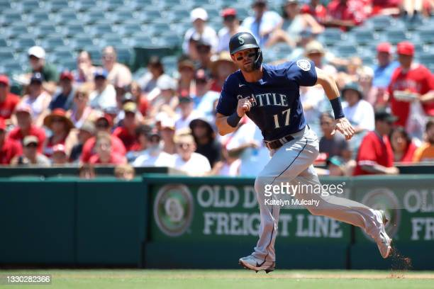 Mitch Haniger of the Seattle Mariners runs to first base during the first inning against the Los Angeles Angels at Angel Stadium of Anaheim on July...