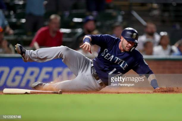 Mitch Haniger of the Seattle Mariners scores on a RBI Single hit by Ryon Healy of the Seattle Mariners against the Texas Rangers in the top of the...