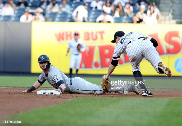 Mitch Haniger of the Seattle Mariners steals second base in the first inning against DJ LeMahieu of the New York Yankees during their game at Yankee...