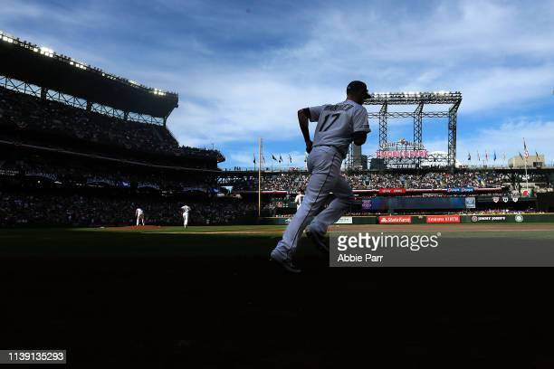 Mitch Haniger of the Seattle Mariners takes the field in the first inning against the Boston Red Sox during their Opening Day game at T-Mobile Park...