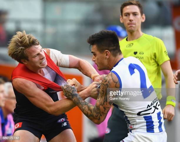 Mitch Hannan of the Demons and Marley Williams of the Kangaroos wrestle during the round nine AFL match between the Melbourne Demons and the North...