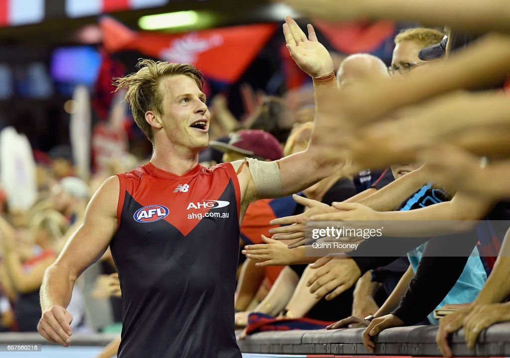 Mitch Hannan of the Demons high fives fans after winning the round one AFL match between the St Kilda Saints and the Melbourne Demons at Etihad Stadium on March 25, 2017 in Melbourne, Australia.