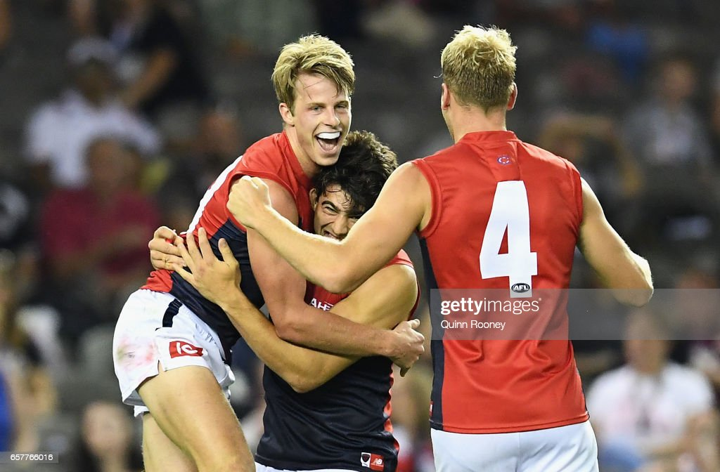 Mitch Hannan of the Demons is congratulated by Christian Petracca and Jack Watts of the Demons during the round one AFL match between the St Kilda Saints and the Melbourne Demons at Etihad Stadium on March 25, 2017 in Melbourne, Australia.