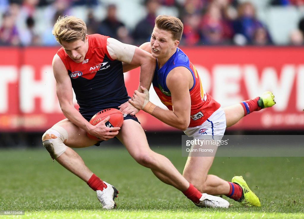 Mitch Hannan of the Demons is tackled by Alex Witherden of the Lions during the round 22 AFL match between the Melbourne Demons and the Brisbane Lions at Melbourne Cricket Ground on August 20, 2017 in Melbourne, Australia.