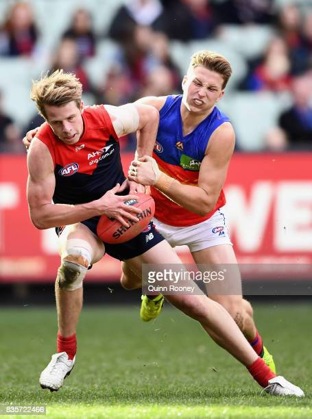 Mitch Hannan of the Demons is tackled by Alex Witherden of the Lions during the round 22 AFL match between the Melbourne Demons and the Brisbane...