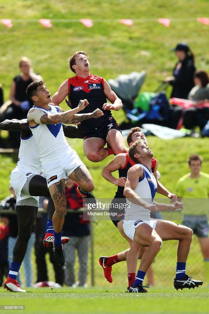 Mitch Hannan of the Demons jumps for a high mark attempt during the JLT Community Series AFL match between the North Melbourne Kangaroos and the Melbourne Demons at Blundstone Arena on February 24, 2018 in Hobart, Australia.