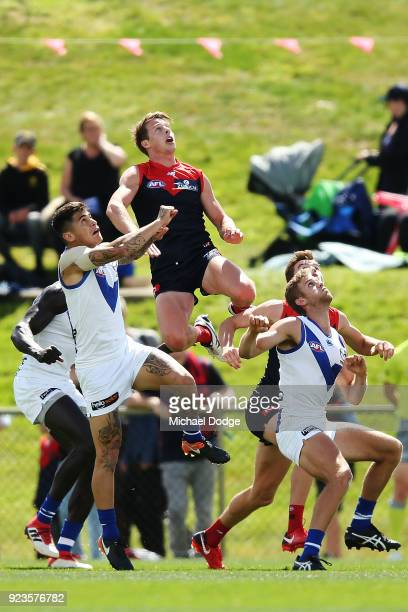 Mitch Hannan of the Demons jumps for a high mark attempt during the JLT Community Series AFL match between the North Melbourne Kangaroos and the...