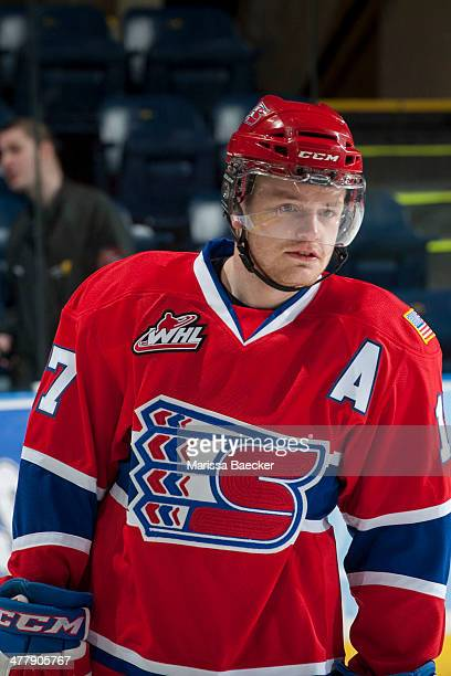 Mitch Holmberg of the Spokane Chiefs stands on the ice against the Kelowna Rockets on March 5 2014 at Prospera Place in Kelowna British Columbia...