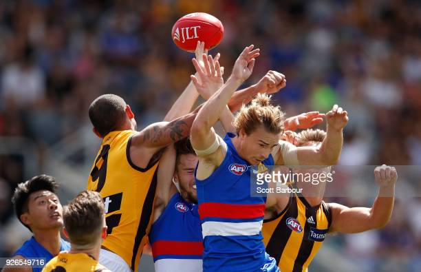 Mitch Honeychurch of the Bulldogs competes for the ball during the AFL JLT Community Series match between the Western Bulldogs and the Hawthorn Hawks...
