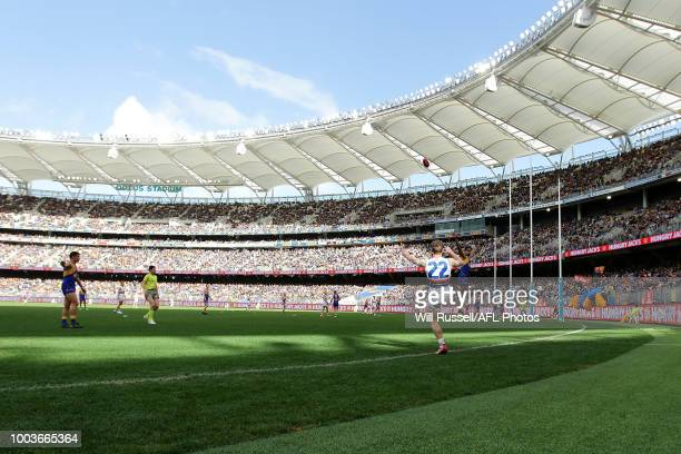Mitch Honeychurch of the Bulldogs lines up a kick on goal during the round 18 AFL match between the West Coast Eagles and the Western Bulldogs at...