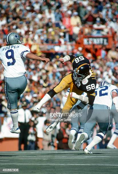 Mitch Hoopes of the Dallas Cowboys gets his punt off under pressure from Jack Lambert of the Pittsburgh Steelers during Super Bowl X on January 18...