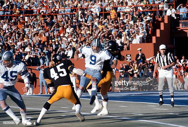 Mitch Hoopes of the Dallas Cowboys punts the ball under pressure from Jimmy Allen of the Pittsburgh Steelers during Super Bowl X January 18 1976 at...