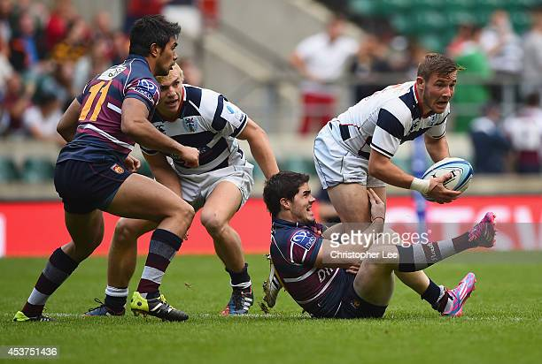 Mitch Hunt of Auckland is tackled by Bautista Guemes of Buenos Aires during the Cup Final match between Buenos Aires and Auckland during the World...