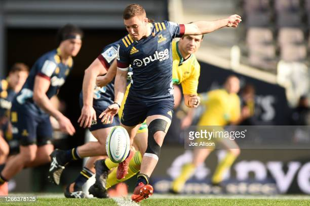 Mitch Hunt of the Highlanders kicks the ball through during the round 10 Super Rugby Aotearoa match between the Highlanders and the Hurricanes at...