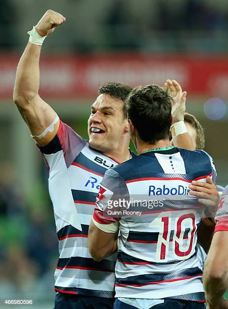 Mitch Inman of the Rebels celebrates scoring a try during the round six Super Rugby match between the Rebels and the Lions at AAMI Park on March 20...