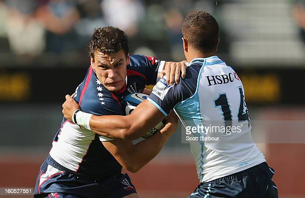 Mitch Inman of the Rebels is tackled during the Super Rugby trial match between the Waratahs and the Rebels at North Hobart Stadium on February 2...