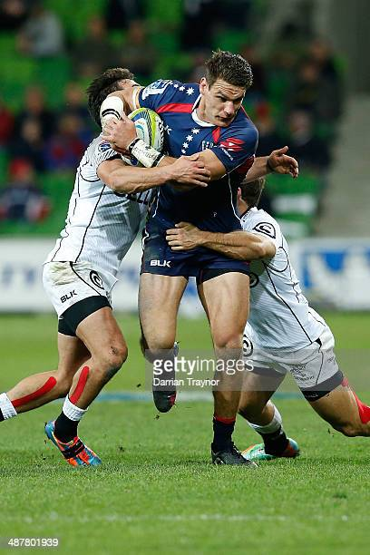 Mitch Inman of the Rebels runs with the ball during the round 12 Super Rugby match between the Rebels and the Sharks at AAMI Park on May 2 2014 in...