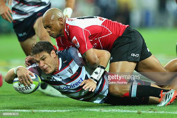 Mitch Inman of the Rebels scores a try during the round six Super Rugby match between the Rebels and the Lions at AAMI Park on March 20 2015 in...