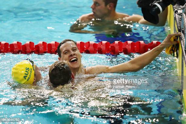 Mitch Larkin Bradley Woodward and Josh Beaver of Australia celebrate following the Men's 200m Backstroke Final on day five of the Gold Coast 2018...