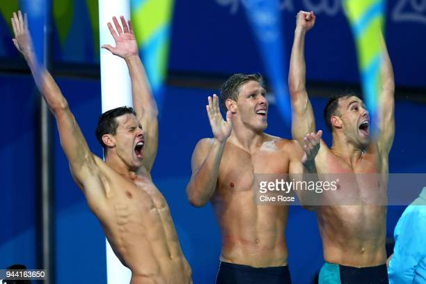 Mitch Larkin Jake Packard and Grant Irvine of Australia celebrate victory in the Men's 4 x 100m Medley Relay Final on day six of the Gold Coast 2018...