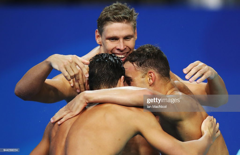 Mitch Larkin, Jake Packard and Grant Irvine of Australia celebrate victory in the Men's 4 x 100m Medley Relay Final on day six of the Gold Coast 2018 Commonwealth Games at Optus Aquatic Centre on April 10, 2018 on the Gold Coast, Australia.