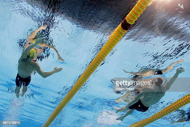 Mitch Larkin of Australia and Ryan Murphy of the United States compete in the Men's 100m Backstroke Final on Day 3 of the Rio 2016 Olympic Games at...