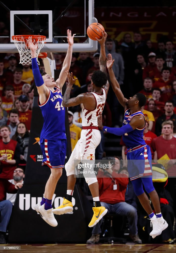 Mitch Lightfoot #44, and Malik Newman #14 of the Kansas Jayhawks block as Zoran Talley Jr. #23 of the Iowa State Cyclones takes a shot in the second half of play at Hilton Coliseum on February 13, 2018 in Ames, Iowa. The Kansas Jayhawks won 83-77 over the Iowa State Cyclones.