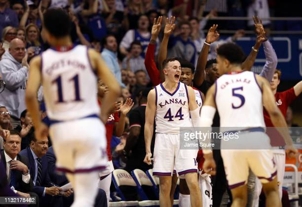Mitch Lightfoot of the Kansas Jayhawks celebrates during the game against the Kansas State Wildcats at Allen Fieldhouse on February 25 2019 in...