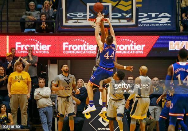Mitch Lightfoot of the Kansas Jayhawks dunks on Sagaba Konate of the West Virginia Mountaineers at the WVU Coliseum on January 15 2018 in Morgantown...