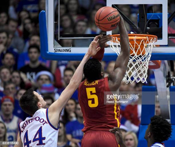 Mitch Lightfoot of the Kansas Jayhawks fouls Merrill Holden of the Iowa State Cyclones on February 4 2017 at Allen Field House in Lawrence Kansas
