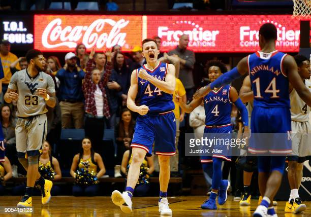 Mitch Lightfoot of the Kansas Jayhawks reacts after dunking on Sagaba Konate of the West Virginia Mountaineers putting Kansas up 6966 at the WVU...