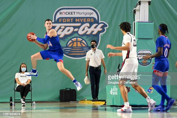 Mitch Lightfoot of the Kansas Jayhawks saves the ball from going out of bounds during the first half against the Gonzaga Bulldogs during the Rocket...